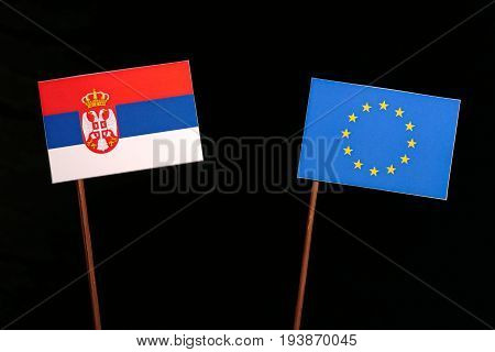 Serbian Flag With European Union (eu) Flag Isolated On Black Background