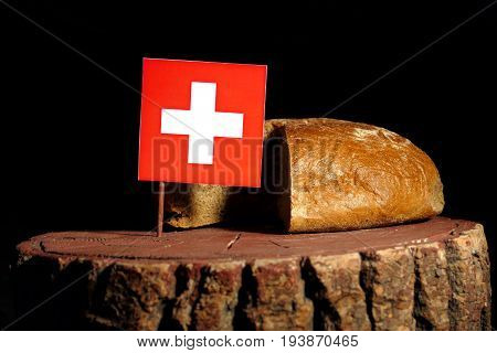 Swiss Flag On A Stump With Bread Isolated