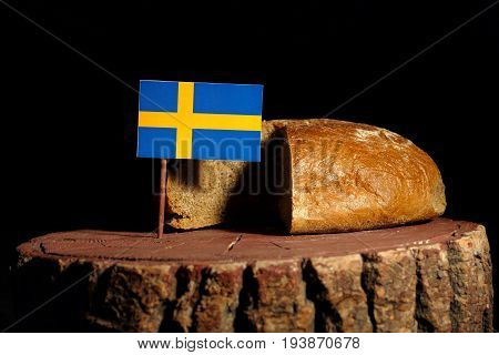 Swedish Flag On A Stump With Bread Isolated