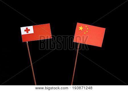 Tongan Flag With Chinese Flag Isolated On Black Background