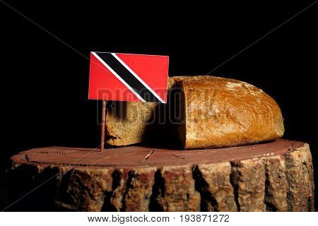 Trinidad And Tobago Flag On A Stump With Bread Isolated