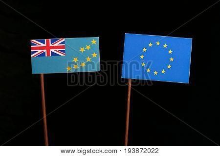 Tuvalu Flag With European Union (eu) Flag Isolated On Black Background