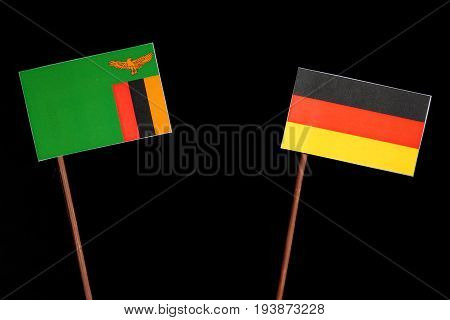 Zambia Flag With German Flag Isolated On Black Background