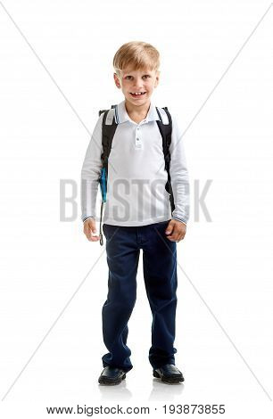 Full portrait of young boy in school uniform with bag