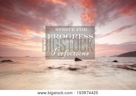 Blurry sunset with Inspirational quote - Strive for progress not perfections