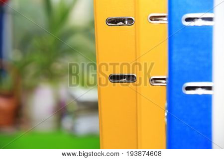 Group of colorful folders close-up. Folders for documents in office.