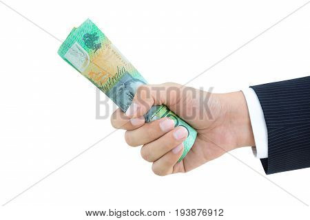 Businessman hand giving roll of money Australian dollars (AUD) on white background