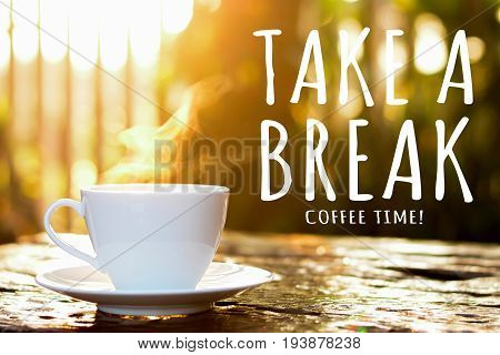 Coffee cup in blur bokeh of morning sunlight background with TAKE A BREAK COFFEE TIME ! text - coffee break poster