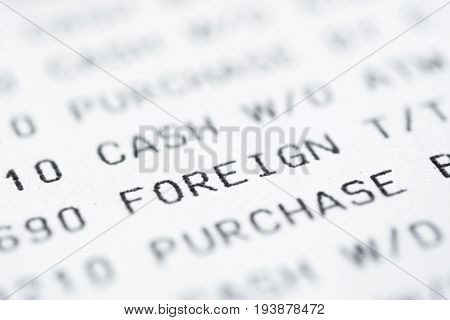 Close up of text on bank statement focused on the word FOREIGN