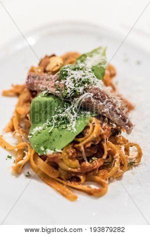 Spaghetti a la puttanesca with anchovy