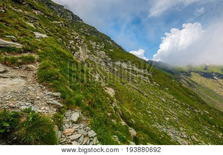 Steep Slope On Rocky Hillside In Clouds