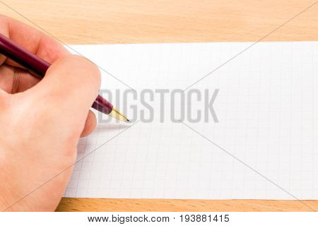 The left hand holds a pen for writing over a blank sheet intending to display its thoughts on this sheet