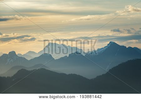 Daybreak over a vast mountain range. Taken from Mount Seymour in North Vancouver, BC, Canada