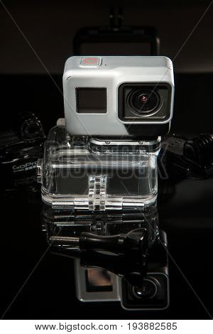 Kharkov, Ukraine - April 13, 2017: GoPro HERO 5 action camera with waterproof case on black background. Compact gadget waterproof, support 4k video and is often used in extreme photography