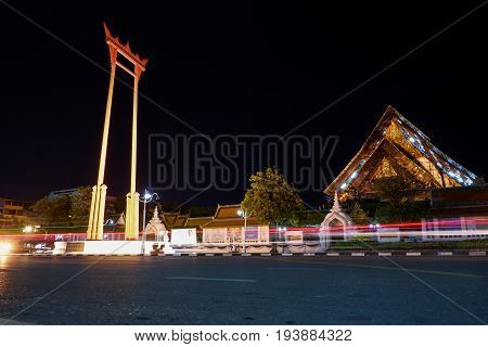 The Giant Swing (Sao Ching cha) landmark in the Bangkok,Thailand. With moving blur light on the night.