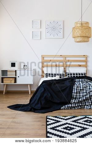 Spacious bedroom with wooden decor and black and white accessories