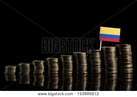 Colombian Flag With Lot Of Coins Isolated On Black Background