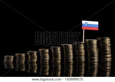 Slovenian Flag With Lot Of Coins Isolated On Black Background