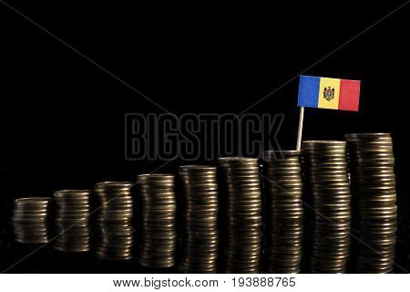 Moldovan Flag With Lot Of Coins Isolated On Black Background