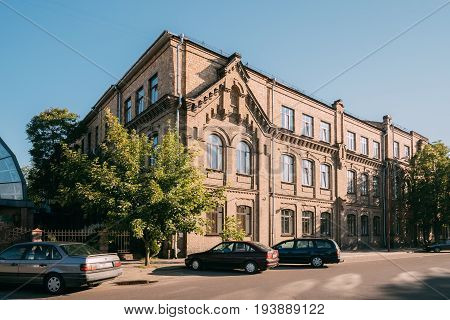 Brest, Belarus - June 6, 2017: Building Of Brest State University Named After A. S. Pushkin At Adam Mickiewicz Street In Sunny Summer Day. Former Gymnasium For Men.