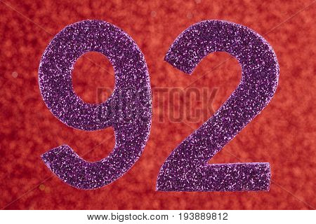 Number ninety-two purple color over a red background. Anniversary. Horizontal