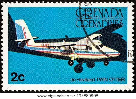 Moscow Russia - July 04 2017: A stamp printed in Grenada shows small passenger airplane De Havilland Canada DHC-6 Twin Otter series circa 1976