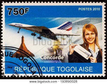 Moscow Russia - July 04 2017: A stamp printed in Togo shows supersonic airliner Concorde and stewardess series