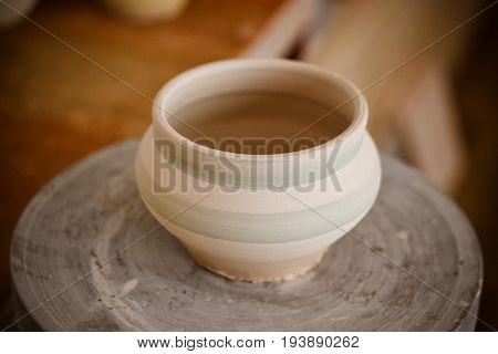 Clay pot on a potter's wheel close-up. Copy spase