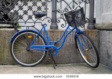 Blue bicycle stands against iron railings in Copenhagen Denmark poster