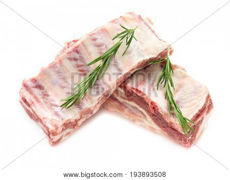 Raw ribs with rosemary isolated on white