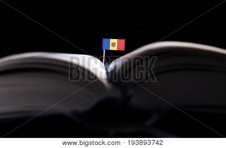Moldovan Flag In The Middle Of The Book. Knowledge And Education Concept.