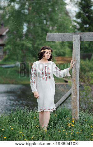 Portrait of a beautiful girl in Slavic clothes. Summertime