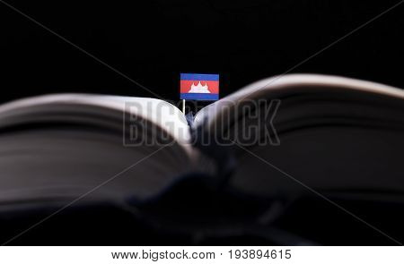 Cambodian Flag In The Middle Of The Book. Knowledge And Education Concept.