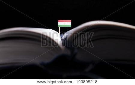 Tajikistan Flag In The Middle Of The Book. Knowledge And Education Concept.