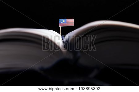 Malaysian Flag In The Middle Of The Book. Knowledge And Education Concept.