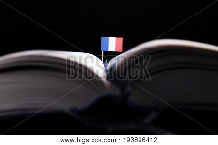 French Flag In The Middle Of The Book. Knowledge And Education Concept.