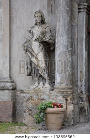 LIEPAJA LATVIA - JUNE 25 2017: Old monument of woman at the entrance of the Lutheran cathedral in Liepaja Latvia