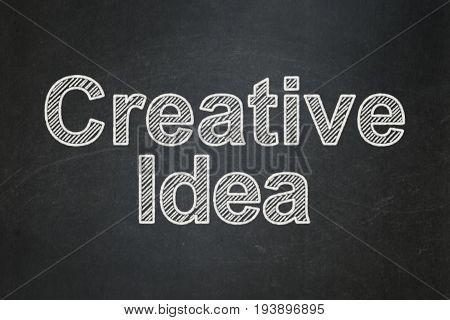 Finance concept: text Creative Idea on Black chalkboard background