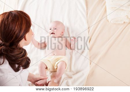 Mama speaks with young son baby family love