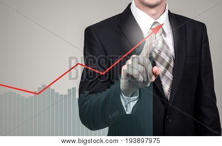 Development and growth concept. Businessman plan growth and increase of positive indicators in his business and finance.