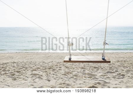 Swing at the beach with sunlighted water in front of the ocean, nusa lembogan, Bali, Indonesia