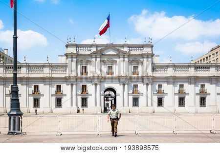 SANTIAGO CHILE - OCTOBER 23 2016: The policeman standing in front of La Moneda Palace (Palacio de La Moneda). It is the seat of the President of the Republic and three cabinet ministers