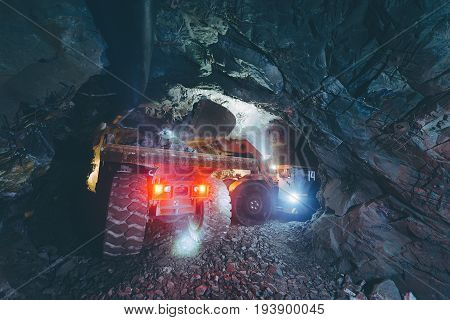 Gold mining deep underground. Golden ore extraction.