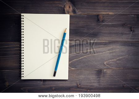 Office Wood Table With Blank Notepad, Pencil.