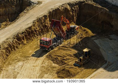 Top View Of Industrial Excavator That  Moving Earth