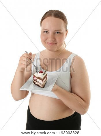 Overweight young woman with piece of cake on white background. Diet concept