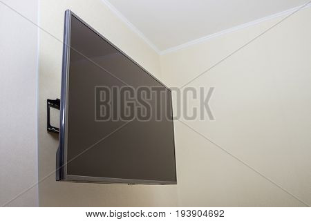 Black LED tv television screen mockup mock up blank on white wall background