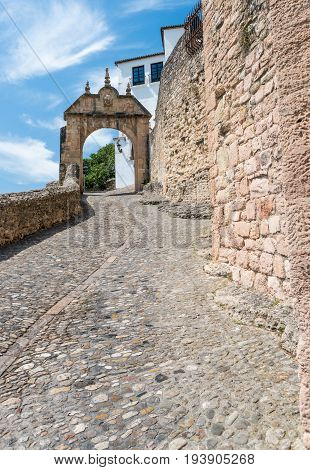 APathway alonf the ancient City Walls and Gateway - Ronda Andalucia Spain