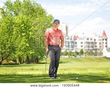 Young man on golf course in sunny day