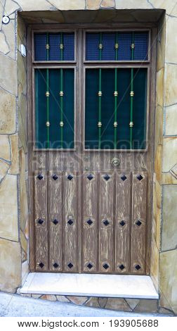 Door With Bars And Pannels